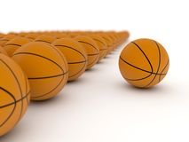 Unique basketball standing out Stock Photography