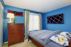 Unique bedroom with bright blue interior. Royalty Free Stock Images