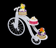 Unique bicycle cake stand with three cakes Stock Photo