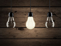 Unique bulb on wooden background Stock Photography
