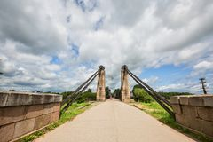 Unique Chain Bridge in the Island City. An unusual chain bridge in the city of Ostrov royalty free stock images