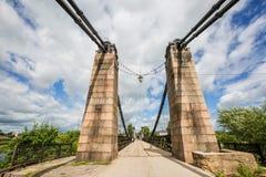 Unique Chain Bridge in the Island City. An unusual chain bridge in the city of Ostrov Stock Photo