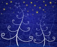 Unique Christmas Trees Blue. A background illustration featuring white abstract Christmas trees set under gold stars on blue background Stock Photos