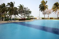 The unique circular pool by the sea. Swimming pool close to the nature of the Thai Gulf Royalty Free Stock Image
