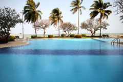 The unique circular pool by the sea. Swimming pool close to the nature of the Thai Gulf Stock Photo