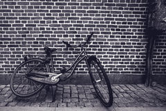 Unique classic vintage hipster bicycle leaning against the stree Royalty Free Stock Photos