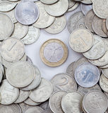 Unique coin in the centre Royalty Free Stock Photos