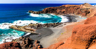 Unique colorful and black sand beaches of volcanic Lanzarote isl Royalty Free Stock Images