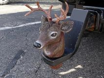 A unique cover for a tow ball hitch in the form of a Reindeer head l. Ocated on the back of a vehicle Stock Image
