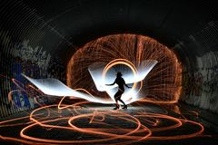Unique Creative Light Painting With Fire and Tube Lighting Stock Photography