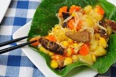 Unique dish of potato salad Stock Images