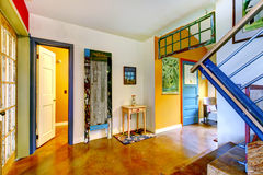 Unique entryway to home with very colorful interior. Stock Photography