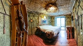 Unique ethnic interior. Traditional, national, design. The hotel room. Ukrainian style and specific decorations of Scythia historical period. Europe, Ukraine Royalty Free Stock Image