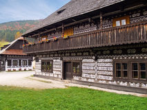Unique folk houses in Cicmany, Slovakia. View of folk houses with specific historical white patterns and decorations which are painted on the exterior walls of Royalty Free Stock Photo