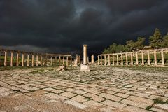 The unique forum of the ancient city of Gerasa after a storm. With dark grey clouds Royalty Free Stock Photos