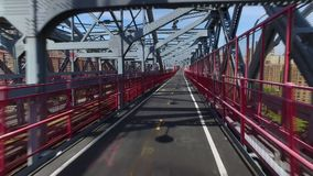 Unique Forward Perspective Traveling on Pedestrian Sidewalk on Williamsburg Bridge. A unique forward perspective of a pedestrian or bicyclist traveling on the stock video