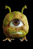 Unique Fruit. A piece of unique fruit has one large eye and looks like a monster Stock Image