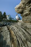 Unique Rock Formations Lead to Lighthouse. Unique geological rock formations lead to Pemaquid Point lighthouse in Maine. It is one of the most popular Stock Photo