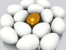 Unique golden egg among white eggs Royalty Free Stock Photo