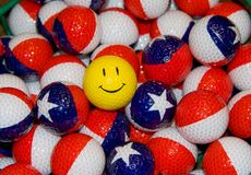 Unique Golfballs. Unique Colorful Golfballs Texas and/or Puerto Rico Theme Flag design with one Happy Face Golfball Stock Photos