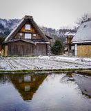 Shirakawago Historic Village in Gifu, Japan. Unique gossho-zukuri houses with a pond at Historic Village of Shirakawago in Gifu, Japan Royalty Free Stock Photo