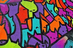 Unique graffiti wall. Graffiti wall, part of the city, where artists decorated the old buildings and factories walls royalty free illustration