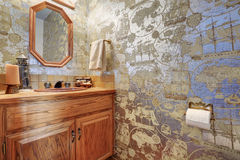 Unique half bathroom with sailor wall paper. Stock Image