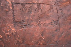 Unique hand carvings on rock. Anasazi Petroglyphs Royalty Free Stock Photo