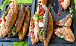 Sandwiches with fresh produce and special bread. stock photos