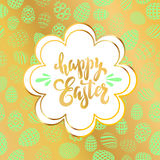 Unique handwritten lettering Happy Easter on a seamless gold bac Stock Photo
