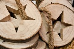 Stars cut in logs home decorations Royalty Free Stock Photos