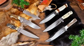 Unique Hunting Knives on wodden Background stock images