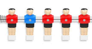 The unique kicker figure. 3d generated picture of a row of kicker figures with an unique blue kicker figure Royalty Free Stock Images