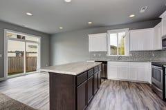 Unique kitchen with gray hardwood floor. Stock Photos