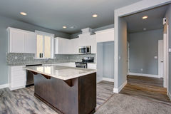 Unique kitchen with gray hardwood floor. Stock Image