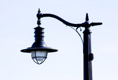 Unique lamp post near rivier Royalty Free Stock Images