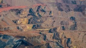Landscape of open pit coal mining in Sangatta, Indonesia. Unique landscape caused by open pit coal mining activity in Sangatta, Indonesia Royalty Free Stock Photo