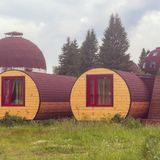 Unique lodgings blend in with nature. Eco housing. House-barrel outdoors. stock photography