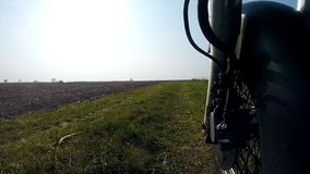 Unique low angle point of view of motorbike while riding on country road. stock video
