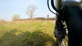 Unique low angle point of view of motorbike while riding on country road. stock footage