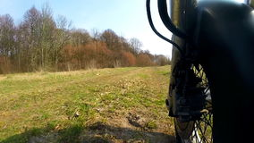 Unique low angle point of view of motorbike while riding on country road. High definition stock video footage clip stock video footage