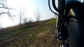 Unique low angle point of view of motorbike while riding on country road. stock video footage