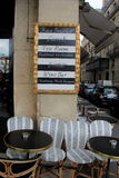 Unique menu on cement post outside cafe,Paris,France,2016. Black and white unique men attached to cement post outside cafe,Paris,France,2016 Royalty Free Stock Photo