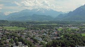 Unique nature of Salzburg, view on city and high Alps mountain from Festungsberg hill. In sunny weather in summer stock footage