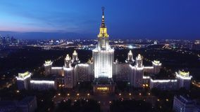 Beautiful evening shot of MSU Moscow State University. Illumination. Stalin skyscraper. Unique night Aerial drone footage. Flight near spire and star, high stock footage
