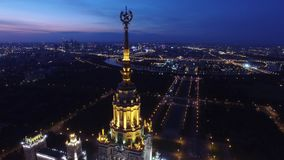 Beautiful evening shot of MSU Moscow State University.  Illumination. Stalin skyscraper. Unique night Aerial drone footage. Flight near spire and star, high stock video footage