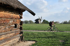 Unique open-air museum Pirogovo, architecture, cyclist Stock Image