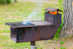 A unique outdoor cooking grill at a campground Stock Image