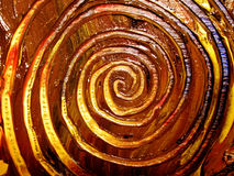 Unique Painted Spiral Patterns. Real fresh oil paint spiral swirls on canvas in browns,yellows,blues, and reds. Perfect as a background, layer or texture stock photo