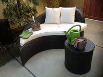 Unique Patio Furniture. Made of brown wicker canvas pillows and cushions and gardening tools Stock Image